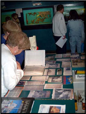 Visitors Viewing 70th Anniversary Artifacts